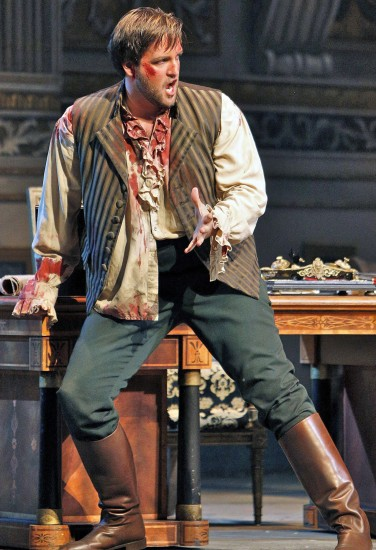 Mario Cavaradossi (Brian Jagde), bloody but unbowed in Act II