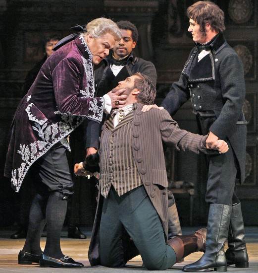 Scarpia, ruthless and sadistic, with Cavaradossi and Spoleto (Joel Sorenson)
