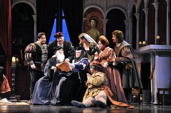 Cast A: The Donati clan; sitting (L to R): Simone (Isaiah Musik-Ayala), Zita (Nicole Birkland), and Betto di Signa (Jo Vincent Parks); standing (L to R): Rinuccio (James Callon), Marco (Peter Tuff), La Ciesca (Tori Grayum), Nella (Jillian Boye), and Gherardo (Robert Norman)