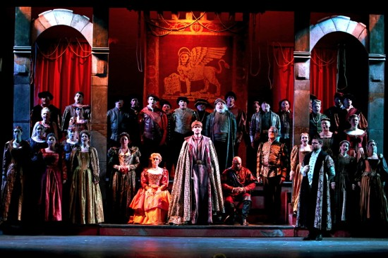 Great Hall scene: Center L to R: Emilia (Michelle Rice), Desdemona (seated - Cynthia Clayton), Lodovico (standing - Matthew Lovell), Otello (seated - David Gustafson), Iago (Philip Skinner), Roderigo (Adam Flowers); Sides and back: West Bay Opera Chorus