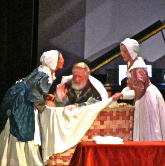 Mistresses Ford and Page hide Falstaff in a dirty laundry basket