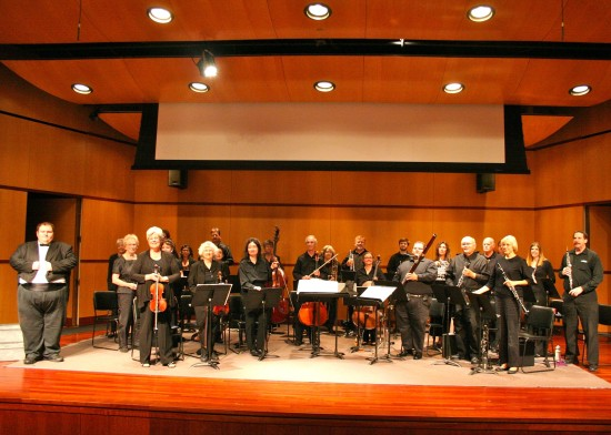 Orchestra with Conductor Jeffrey Yaeger (extreme L)