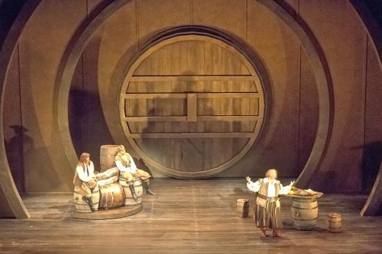"Interior of Falstaff's ""room"" at the Garter Inn; Johann Schram Reed as Pistola, Chris Coyne as Bardolfo, Steven Condy as Falstaff; photo by Bob Shomler"