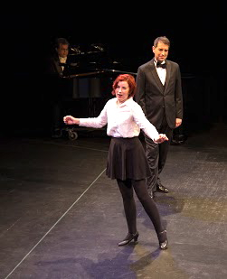 """Irene (Diane Squires) sings the hit song """"Alice-Blue Gown""""; Donald (Andrew Solovay) watches with approval"""