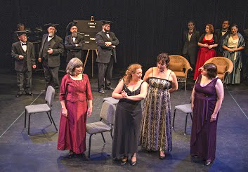 "Eleanor and ""the girls"" (June Melchior, Katherine Chapin (Eleanor), Connie Kleinjans, and Kathy Kriese) sing about genealogy as a hobby; Will Todd, Barry Hayes, Mark Baushke, and Patrick Shapiro are the Professors of Genealogy"