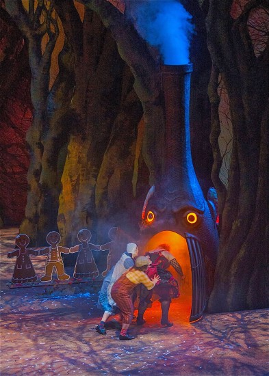 Cast 1: Hansel and Gretel shove the witch into her oven; photo by Bob Shomler