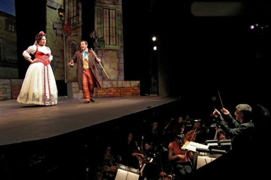 Adina and Dulcamara sing the ballad of the farm girl and the senator; José Luis Moscovich conducts the orchestra